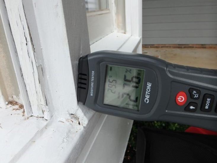 moisture meter reading moisture near window